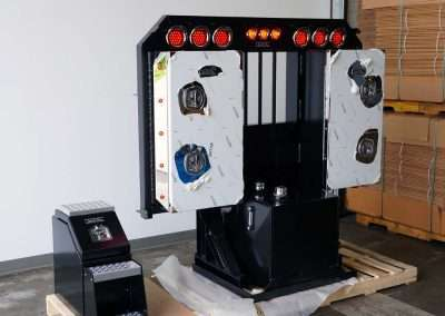 Black flat rack with cabinets, light bar, and hydraulic tank