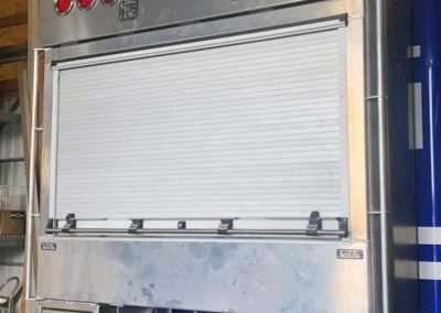 Roll-Up Door Enclosed Headache Rack