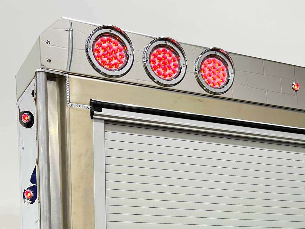 Enclosed Headache Rack Will Roll-Up Door and LED Lights