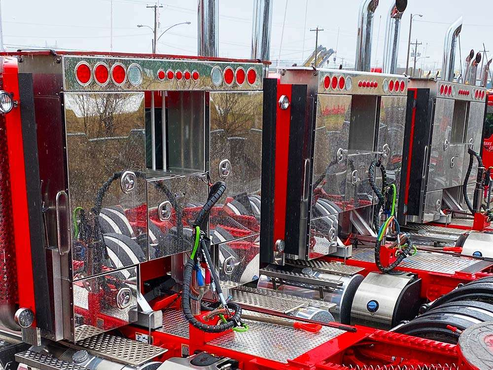 Stainless Steel Enclosed Headache Racks on a Fleet of Trucks