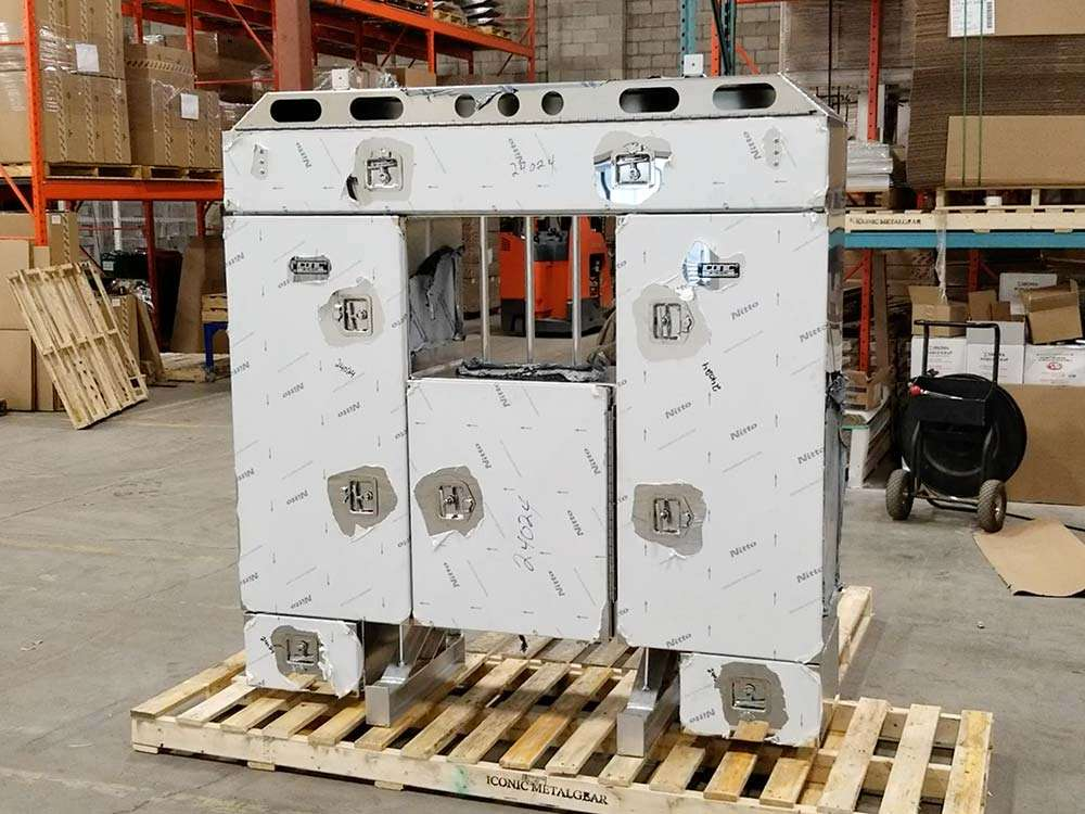 Twin custom enclosed headache racks with stainless steel doors